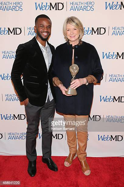 Violinist Lee England Jr and Martha Stewart pose with an award backstage at the 2014 Health Hero Awards hosted by WebMD at Times Center on November 6...