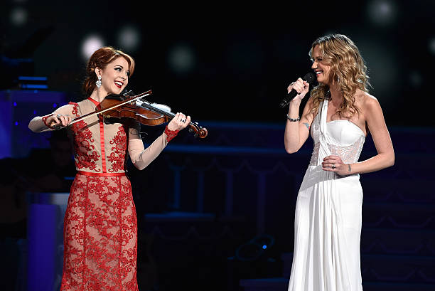 violinist lindsey stirling and host jennifer nettles perform during the cma 2015 country christmas on november - Cma Country Christmas 2015