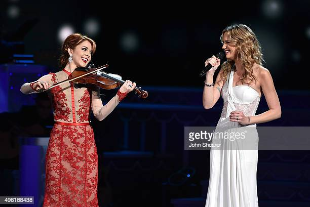 Violinist Lindsey Stirling and host Jennifer Nettles perform during the CMA 2015 Country Christmas on November 7 2015 in Nashville Tennessee