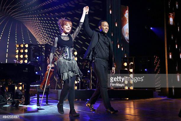 Violinist Lindsey Stirling and pianist John Legend take a bow after performing All of Me to close the YouTube OnStage Live from the Kennedy Center...