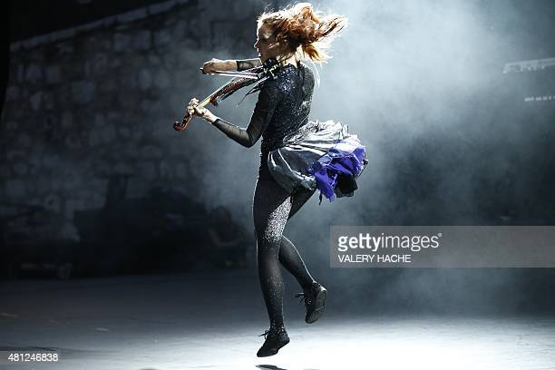 US violinist Lindsey Stirling performs on stage on July 18 2015 in Nice southeastern France AFP PHOTO / VALERY HACHE