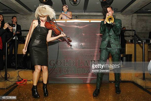 Violinist Margot and DJ Mia Moretti of The Dolls and trumpeter Spencer Ludwig of Capital Cities perform at Johnnie Walker's toast of the launch of...