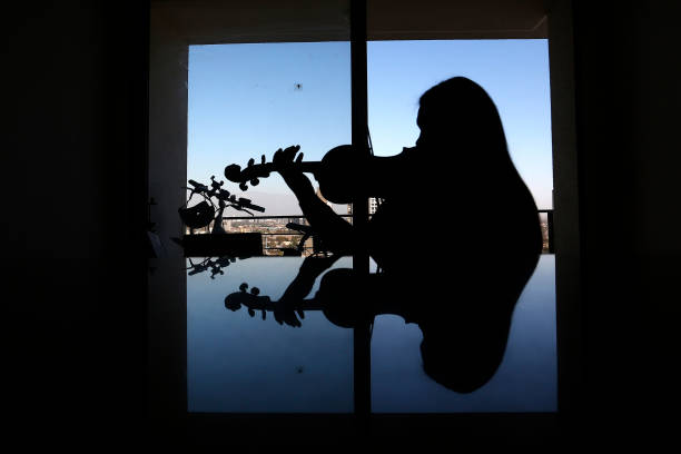 CHL: Violin Teacher Conducts Online Lessons From Home During Coronavirus Partial Shutdown