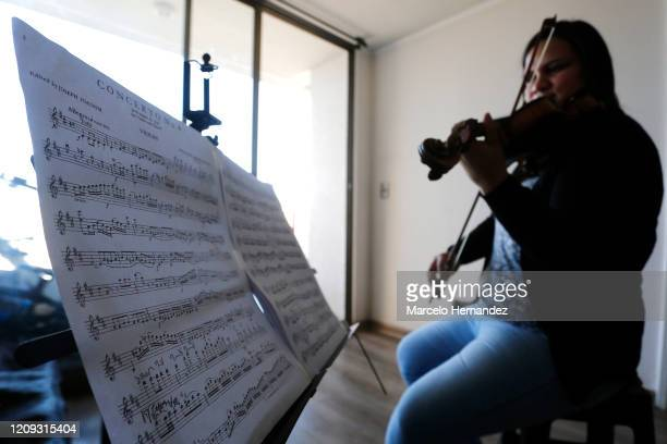 Violinist Marlly Palacios gives an online lesson through Skype on April 6 2020 in Santiago Chile Palacios is a Venezuelan violinist who plays in the...