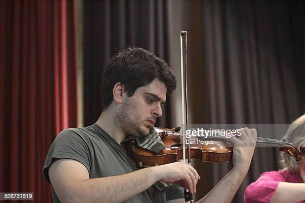 Violinist Michael Barenboim son of pianists Daniel Barenboim and Elena Bashkirova plays the violin in rehearsal on the stage of the Mary Nathaniel...