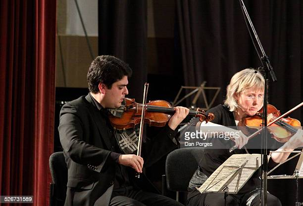 Violinist Michael Barenboim son of pianists Daniel Barenboim and Elena Bashkirova and violinist Kathrin Rabus play in concert on the stage of the...
