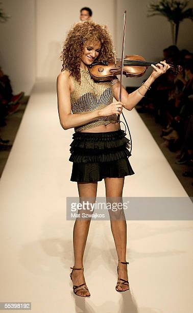Violinist Miri BenAri performs on the runway at the Chris The Iceman Aire new collection fashion show at the New York Public Library during Olympus...