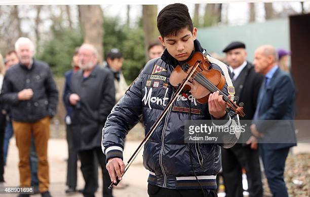 A violinist performs outside the Memorial to the Sinti and Roma of Europe Murdered Under National Socialism on International Romani Day on April 8...