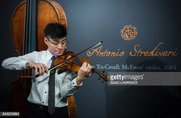 A violinist plays a rare 1684 violin by Antonio Stradivari during a media preview at Sotheby's in Hong Kong on February 21 ahead of the violin's...