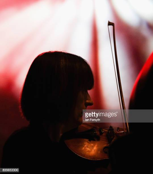 A violinist with the London Gala Orchestra performs during the annual Castle Howard Proms Spectacular concert held on the grounds of the Castle...