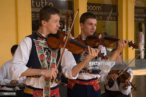 Violinists in traditional music group.