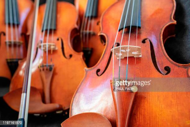 Violins are seen in the workshop of Martin McLean near Cookstown County Londonderry Northern Ireland on January 22 2020 Carving amber wood and...