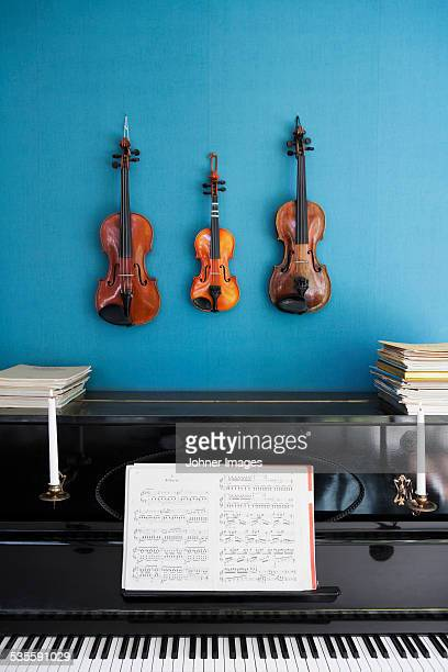 Violins hanging over piano