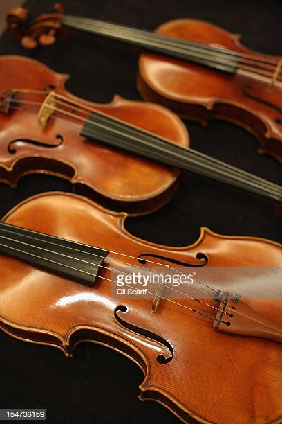 Violins which feature in an exhibition of the work of JeanBaptiste Vuillaume are disdplayed at Sotheby's auction house on October 25 2012 in London...