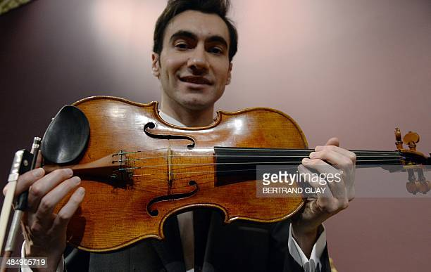 US violist David Aaron Carpenter holds the 'Macdonald' Stradivarius viola created in 1719 by Antonio Stradivari at Sotheby's auction house in Paris...