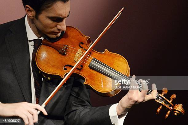 US violist David Aaron Carpenter plays the 'Macdonald' Stradivarius viola created in 1719 by Antonio Stradivari at Sotheby's auction house in Paris...