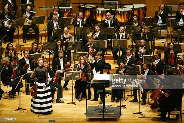 Violist Leila Josefowicz greets the audience during a concert by the National Orchestra of Belgium at Suntory Hall during Belgian Prince Laurent's...