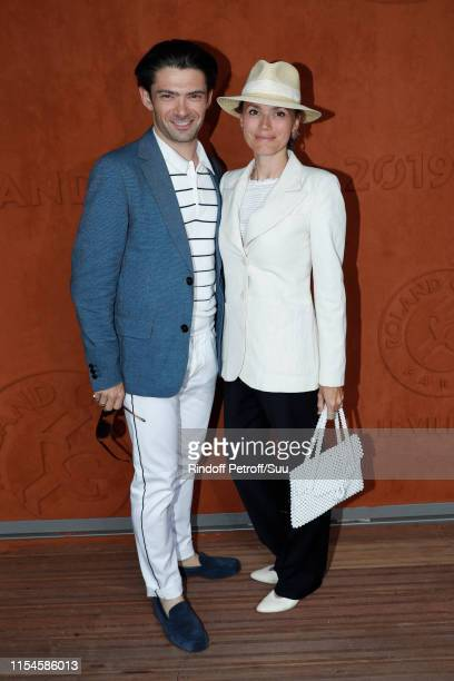 Violoncellist Gautier Capucon and his wife Delphine attend the 2019 French Tennis Open - Day Fourteen at Roland Garros on June 08, 2019 in Paris,...