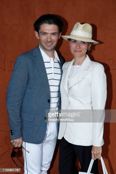 Violoncellist Gautier Capucon and his wife Delphine attend the 2019 French Tennis Open Day Fourteen at Roland Garros on June 08 2019 in Paris France
