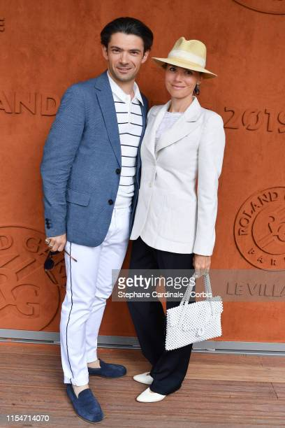 Violoncellist Gautier Capucon and his wife Delphine attends the 2019 French Tennis Open - Day Fourteen at Roland Garros on June 08, 2019 in Paris,...