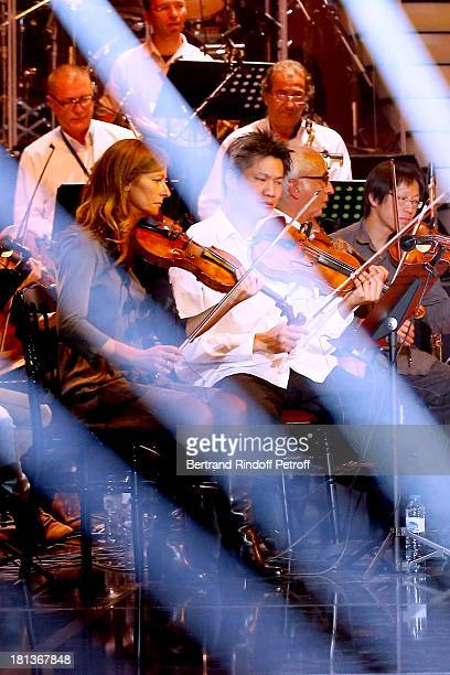 Violonist Anne Gravoin (1st L) and orchestra perform at 'Le Grand Show' by Laurent Gerra : Rehearsal at La Plaine Saint Denis on September 20, 2013 in Paris, France.