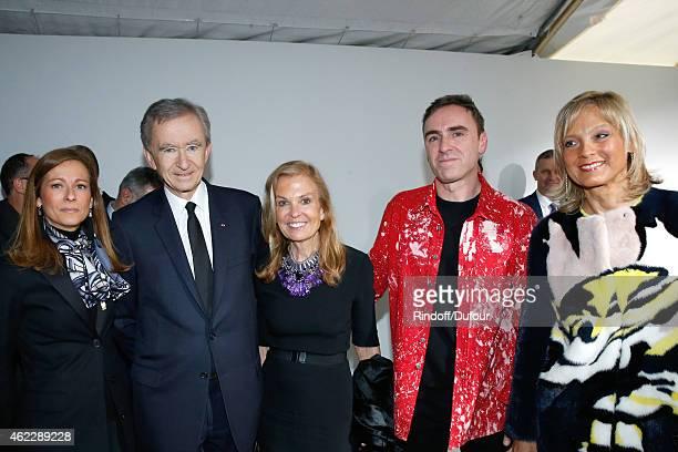 Violonist Anne Gravoin Owner of LVMH Luxury Group Bernard Arnault Ambassador of USA in France Jane D Hartley Fashion Designer Raf Simons and Helene...