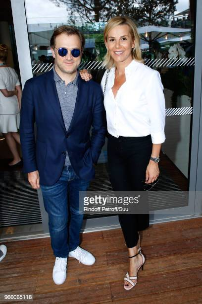 Violonist Renaud Capucon and his wife journalist Laurence Ferrari attend the 2018 French Open Day Seven at Roland Garros on June 2 2018 in Paris...