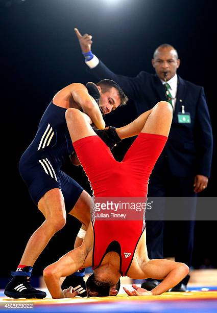 Viorel Etko of Scotland competes with Adam Vella of Malta in the Men's FS 61kg Bronze medal match at the Scottish Exhibition and Conference Centre...