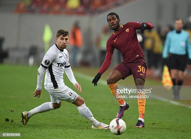 Viorel Nicoara of Astra Giurgiu vies for the ball with Gerson of AS Roma during the UEFA Europa League Group E football match between FC Astra...