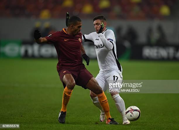 Viorel Nicoara of Astra Giurgiu vies for the ball with Juan of AS Roma during the UEFA Europa League Group E football match between FC Astra Giurgiu...