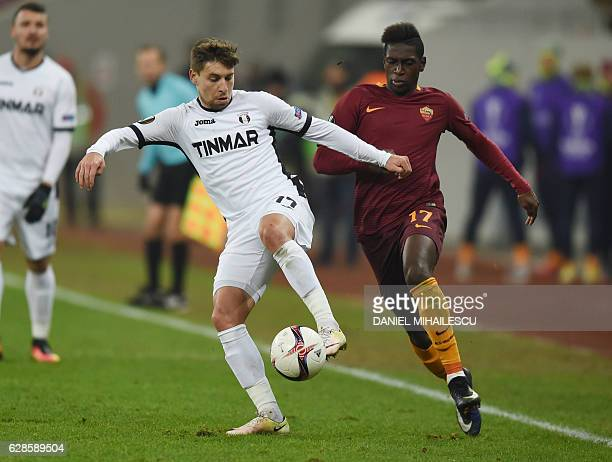 Viorel Nicoara of Astra Giurgiu vies for the ball with Moustapha Seck of AS Roma during the UEFA Europa League Group E football match between FC...