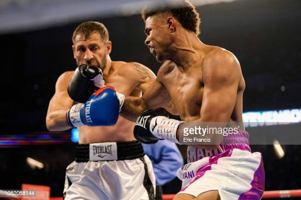 Viorel Simion and Shakur Stevenson fight during their match at at CHI Health Center on October 13 2018 in Omaha Nebraska