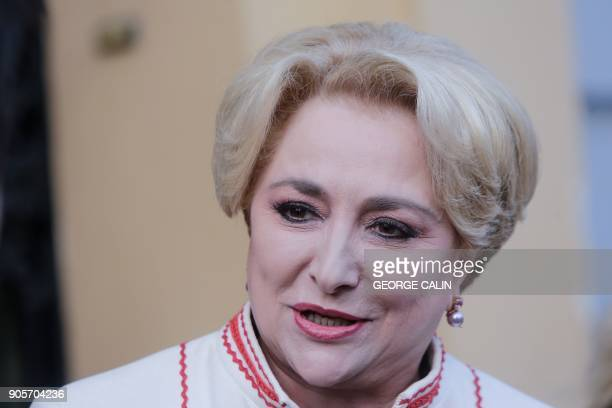 Viorica Dancila PSD's nomination for Prime Minister of Romania talks to the media as she leaves the party's headquarters in Bucharest on January 16...