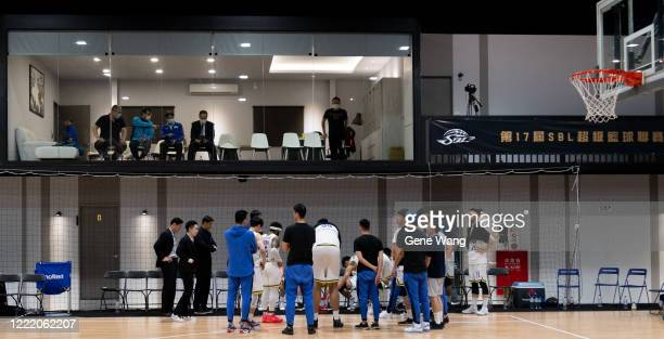 Vips can only watch the game from the window when team Yulon Luxgen Dinos discuss in the empty court during the SBL Finals Game Six between Taiwan...