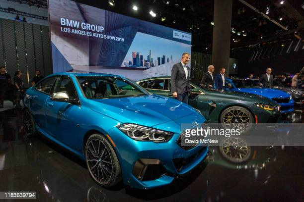 VIPs take the stage as the BMW 2 Series Gran Coupe is shown during its world premiere at AutoMobility LA on November 20, 2019 in Los Angeles,...