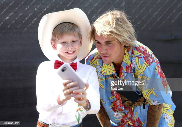 Viral internet sensation Mason Ramsey aka The Walmart Yodeling Boy and Recording Artist Justin Bieber pose for a selfie backstage during the 2018...