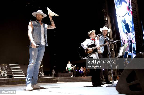 Viral internet sensation Mason Ramsey aka The Walmart Yodeling Boy Brian Kelley and Tyler Hubbard of Florida Georgia Line perform onstage during 2018...
