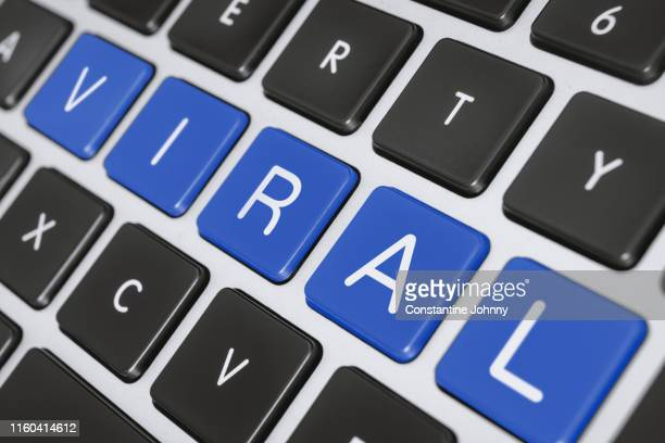 viral word on computer keyboard keys - meme stock pictures, royalty-free photos & images