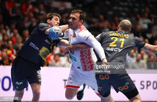 Viran Morros and Joan Cañellas of Spain challenge Dzmitry Nikulenkau of Belarus during the Men's EHF EURO 2020 main round group I match between...