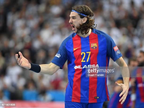 Viran Morros De Argila of Barcelona celebrates during the EHF Champions League Quarter Final first leg match between THW Kiel and Barcelona at the...