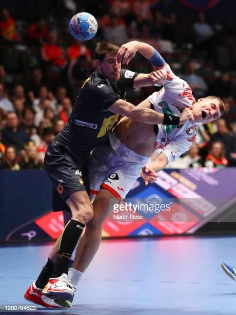 Viran Morros of Spain challenges Uladzislau Kulesh of Belarus during the Men's EHF EURO 2020 main round group I match between Belarus and Spain at...