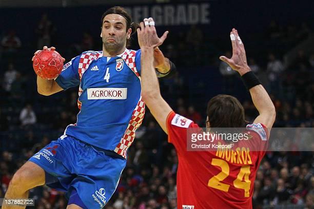 Viran Morros of Spain defends against Ivano Balic of Croatia during the Men's European Handball Championship bronze medal match between Croatia and...