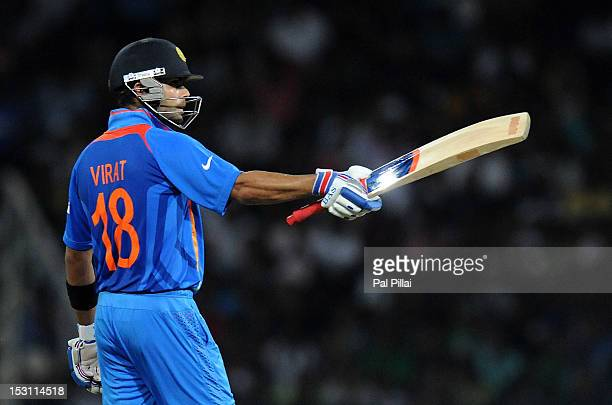 Virat Kholi of India raises his bat after scoring a half century during the ICC T20 World Cup Super Eight group 2 cricket match between Pakistan and...