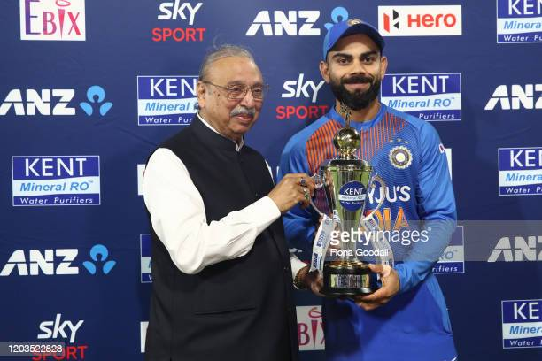 Virat Kohli accepts the series trophy during game five of the Twenty20 series between New Zealand and India at Bay Oval on February 02, 2020 in Mount...