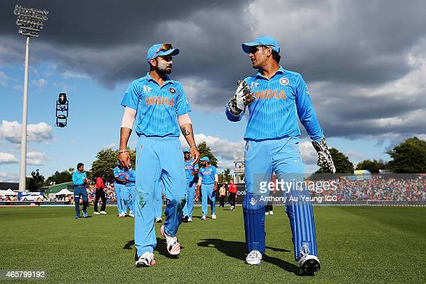 Virat Kohli and MS Dhoni of India come off the field after their innings during the 2015 ICC Cricket World Cup match between Ireland and India at...