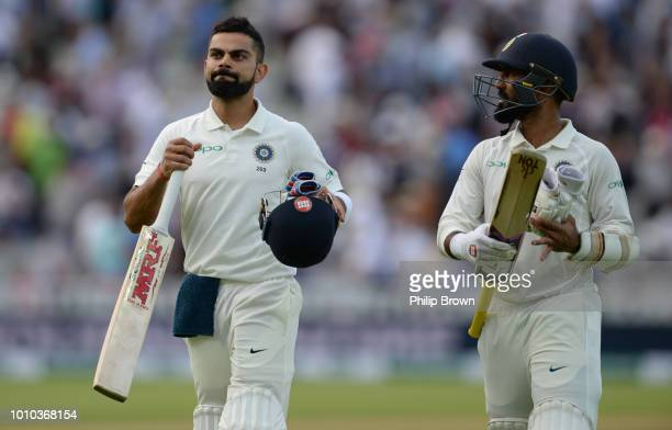 Virat Kohli and Dinesh Karthik leave the field at stumps after the third day of the 1st Specsavers Test Match between England and India at Edgbaston...