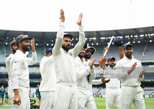 Virat Kohli and his Indian team mates celebrate winning the test during day five of the Third Test match in the series between Australia and India at...