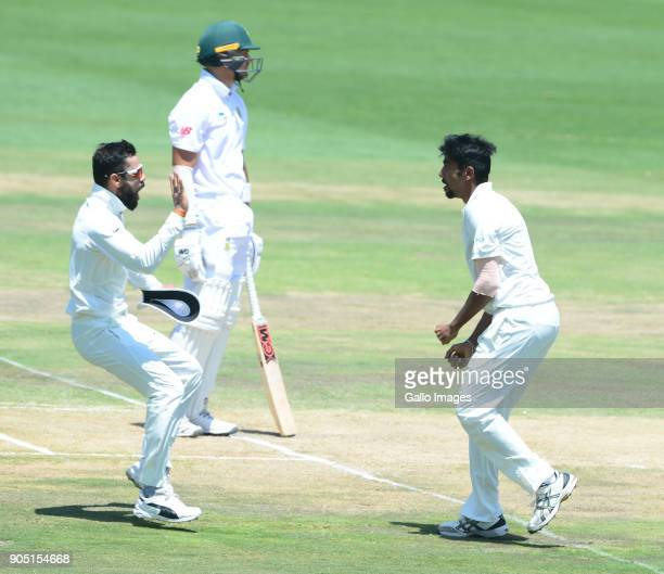 Virat Kohli and Jasprit Bumrah of India celebrate the wicket of Aiden Markram of the Proteas during day 3 of the 2nd Sunfoil Test match between South...
