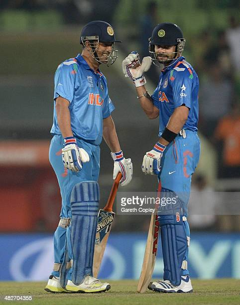 Virat Kohli and Mahendra Singh Dhoni of India share a joke during the ICC World Twenty20 Bangladesh 2014 semi final between India and South Africa at...