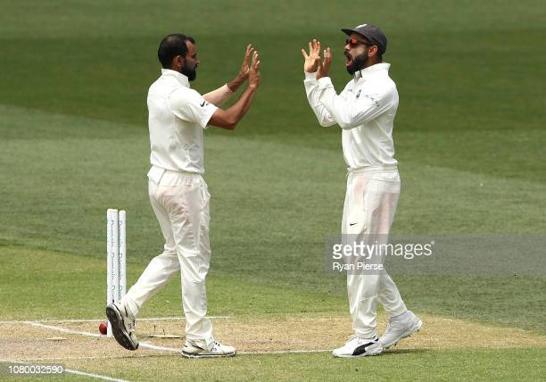 Virat Kohli and Mitchell Starc of Australia celebrates after Shami took the wicket of Mitchell Starc of Australia during day five of the First Test...